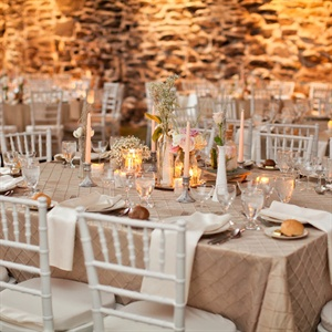 Taupe linens, ivory napkins and soft, romantic centerpieces created a beautiful look at the reception.