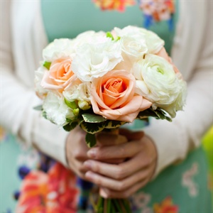 The girls carried white and peach roses, freesia and ranunculus.