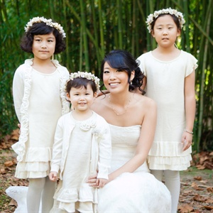 The three flower girls wore white dresses and Sue Jean's mom made their headpieces with flowers and ribbons.