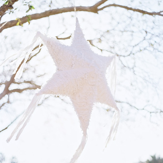 Star-shaped piñatas hanging from the trees outside the chapel added charm and romance to the day.