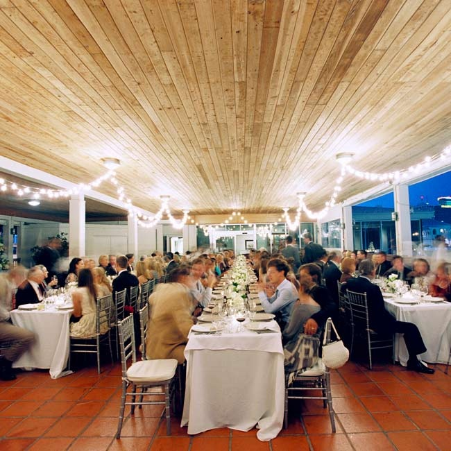 Café lights filled the space with a warm glow as guests enjoyed waterfront views from their seats.