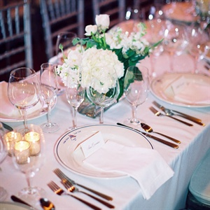 White tablecloths, dishware and centerpieces kept the reception looking crisp.