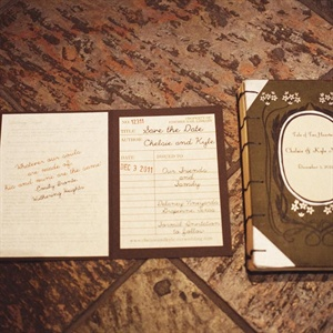 Made to look like vintage books with library stamp cards inside, the save-the-dates gave guests a preview of the theme to come.