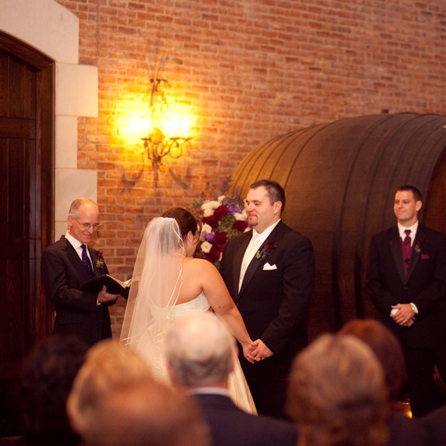 Chelsie and Kyle exchanged traditional vows surrounded by real wine barrels.