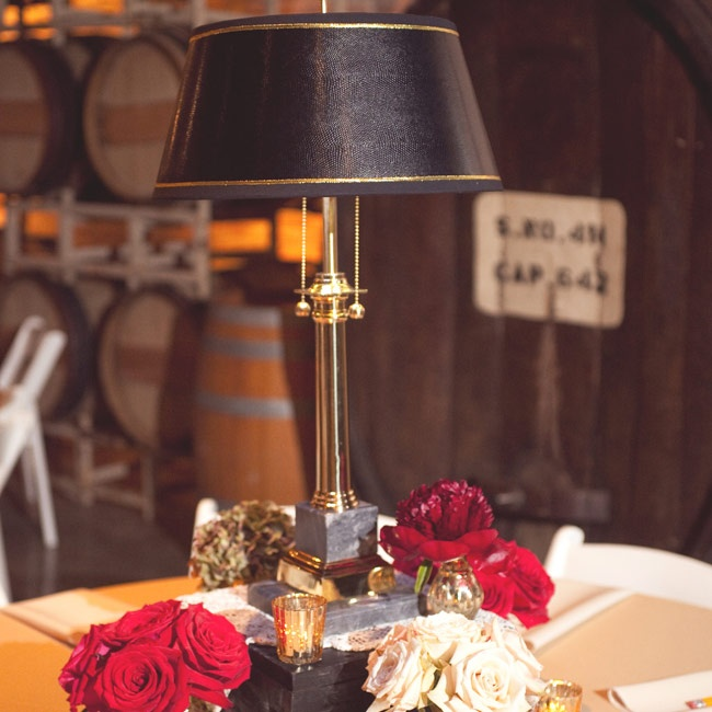 Antique library lamps, stacks of old books and small arrangements of roses perfectly encapsulated the wedding's theme.
