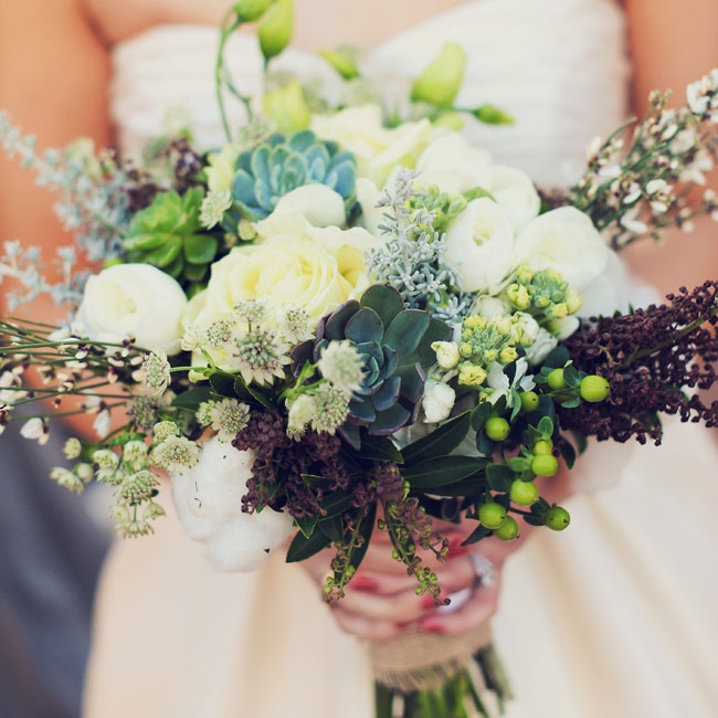 Emma carried a wild bunch of ranunculus, berries, raw cotton and succulents.