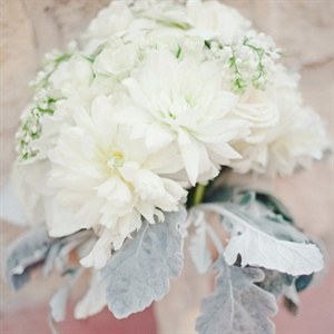 Dusty miller was wrapped around the bouquet of dahlias, sweet peas, roses and peonies.