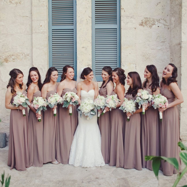 The nine bridesmaids all wore the same dress to mirror Stephanie's sweetheart neckline.