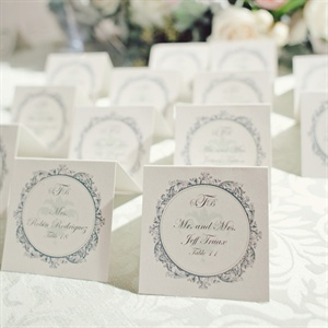 Small tented cards in the same style as the invites led guests to their seats.