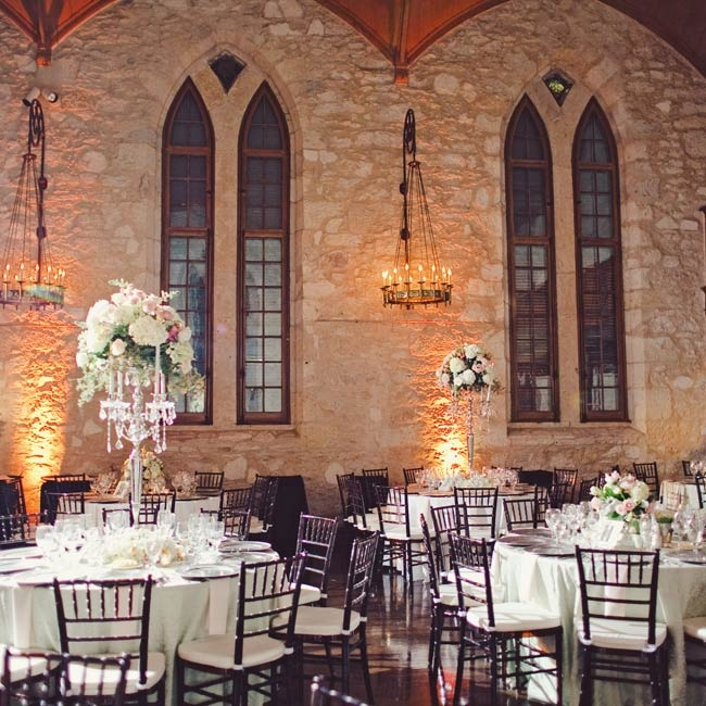 Pink centerpieces accented with hanging crystals brought elegance to the rustic venue.