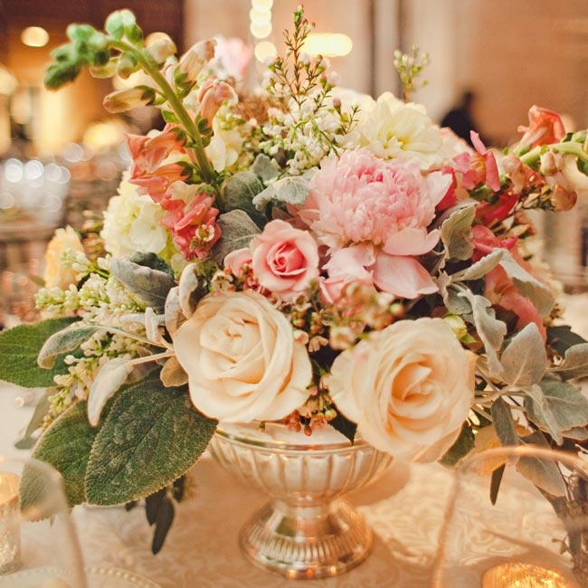 Lush centerpieces of roses, peonies and snapdragons took on a vintage-looking vibe, thanks to the varied shades of pink.
