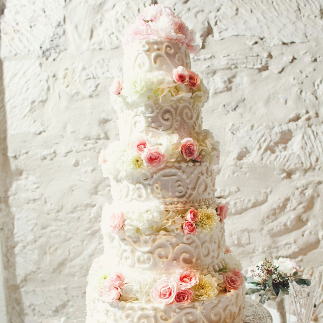 Frosting swirls and layers of fresh flowers glammed up the five-tiered cake.