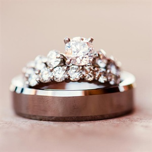 "Melissa's engagement ring is the ""floating diamond engagement ring"" in platinum from Blue Nile, purchased online from bluenile.com.  Her wedding band was crafted by a local jeweler using some of her mother's diamonds, which she'd always wanted to incorporate into her wedding band, since her parents have been married over 45 years!"