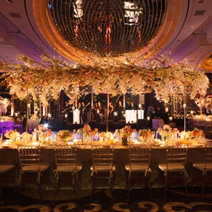 A mix of inventive arrangements—from hanging floral canopies to flower balls suspended in water—added major drama to the main room.