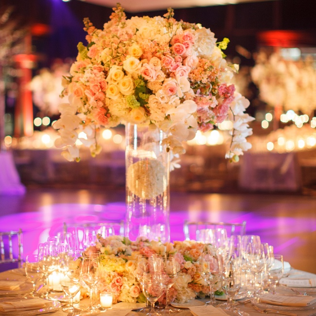 The centerpieces included an assortment of pastel pink flowers including roses, orchids and even flower balls suspended in water.