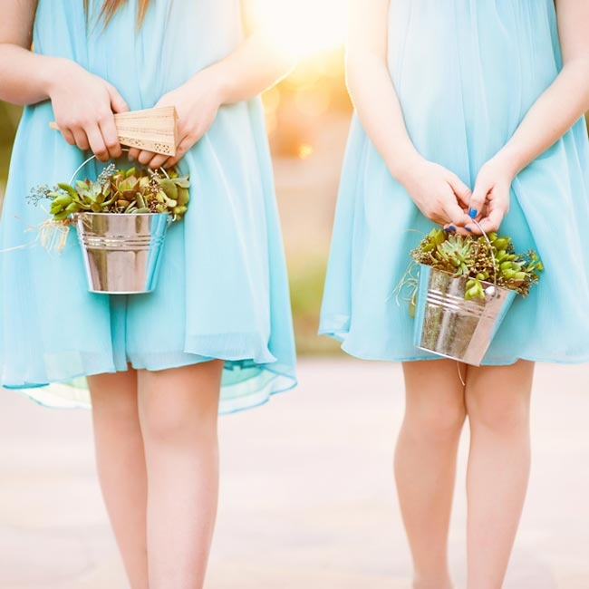 Melissa and Sean's nieces served as flower girls. The older two carried baskets of succulents while the younger two carried baskets of white rose petals, and their baskets were accented with succulents on the handles.