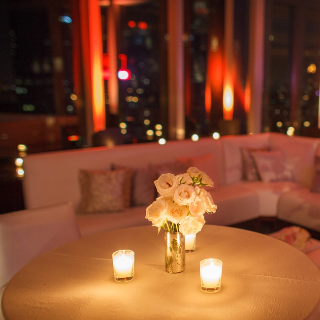Low lighting and white rose centerpieces set the mood for cocktail hour at the Mandarin Oriental.