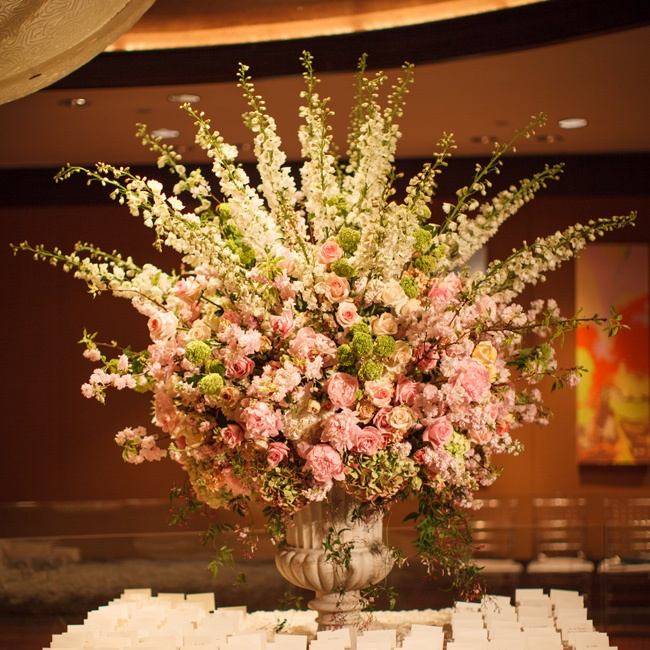 A lush bed of flowers elevated the simple, elegant cards.