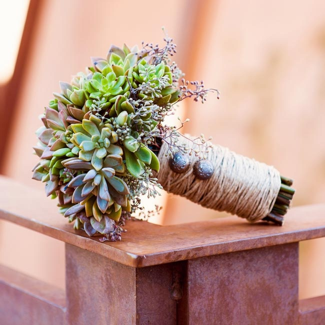 Melissa and Sean both grew up the in the desert, so succulents so we felt very fitting. The environmentally conscious couple couldn't stand the idea of throwing out the flowers after the wedding so they also chose succulents because they were able to replant them after the wedding day.