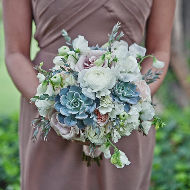 The girls carried lush bouquets of roses, ranunculus, succulents and greenery.