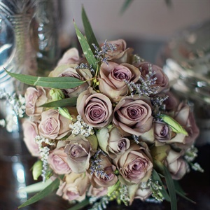 The bridal bouquet, which was mainly made up of different color Amnesia roses, was wrapped in two handkerchiefs one belonging to the brides mother and the other to the grooms great-grandmother both of which they had carried on their own wedding day.