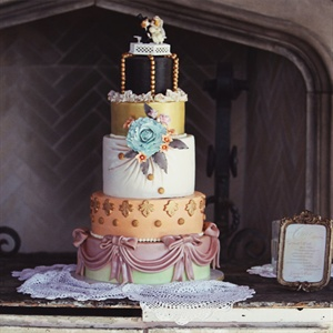 Each tier of the cake had its own funky design, but the pastel colors helped tie it all together.