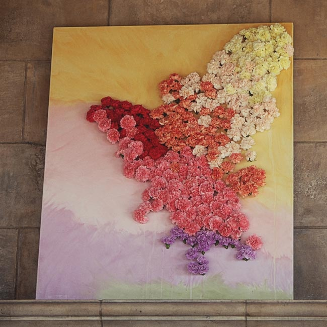 A huge watercolor painting, with fresh blooms in vibrant colors, decorated the dance floor area.