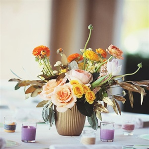 Garden roses, ranunculus, tulips and a mix of leaves made for sweet table arrangements.