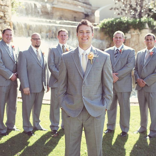 All the guys wore gray suits, with the groomsmen in ties coordinated to match the bridesmaid dresses.