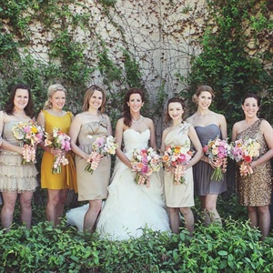 The bride selected dresses in shades of gold and gray that matched each of her eight maids' personalities.