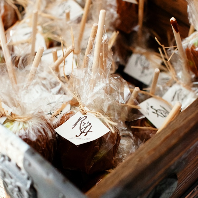 Haley and Ryan made the caramel apple favors. Each one was speared with a wooden stick wrapped in clear plastic, tied with raffia ribbon and the couple's R&H 10/08/12 wedding logo tag.