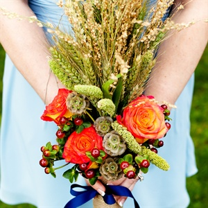 The bridesmaids' bouquets had more of a vertical feel to them with lots of wheats and grasses. Each bouquet had a few circus roses, chocolate hypericum berries and tied together with the natural burlap and a navy grograin ribbon.