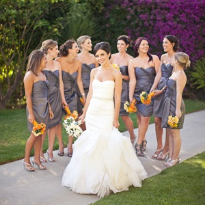 Lindsey wore a romantic strapless gown with ruffles on the skirt. Her bridesmaids coordinated in slate gray strapless dresses.