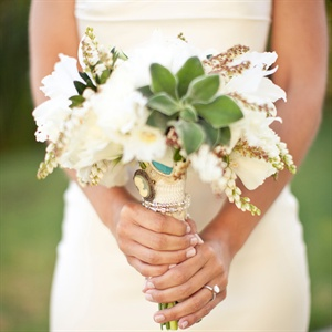 Lindsey carried her something borrowed, blue and new on her white and green bouquet.