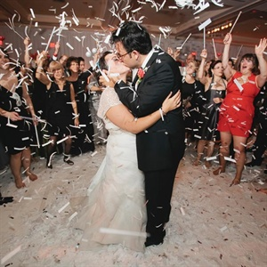 At the end of the night, all the guests surrounded the couple on the dance floor and showered theme with paper streamers.