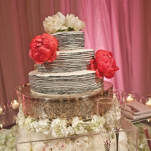 Lauren and Martin went bold with their cake - white with black stripes and accented with peonies.