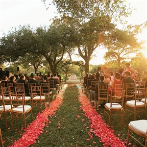 The aisle was highlighted with petals in a gradient from coral to white, creating an ombré effect.