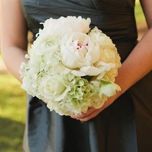 The women carried all-white bouquets of peonies, hydrangeas and ranunculus.