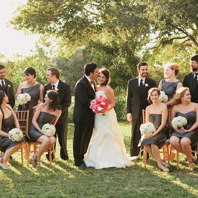 The bridesmaids wore gray cocktail dresses in various styles, and the guys donned classic black tuxes.