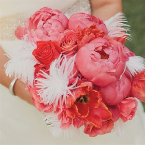 White feathers were mixed in with the coral peonies, tulips and roses in Lauren's bouquet for a vintage-glam feel.