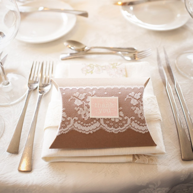 Caroline wrapped the favor boxes in lace for a feminine touch. Inside was jasmine bloom tea.