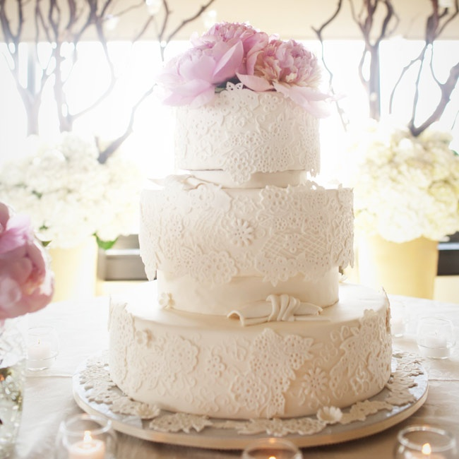 Topped with pink peonies and covered in fondant lace, the cake was utterly romantic.
