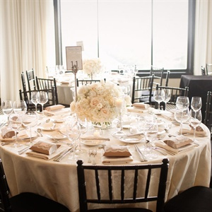 Lush white hydrangeas, roses and tulips, paired with ivory table linens, created an airy look for the reception.