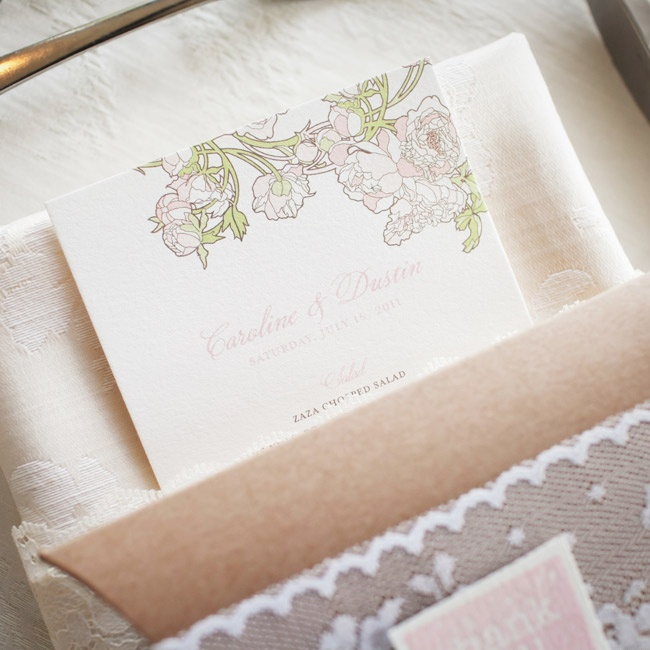 A delicate floral design brought the couple's theme into the menu cards.