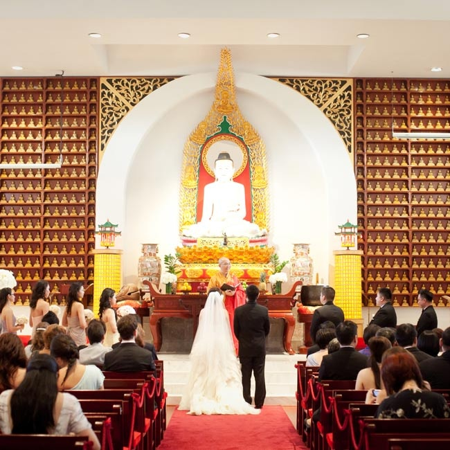 The Buddhist temple where the couple married was already beautiful, so they kept the décor simple.