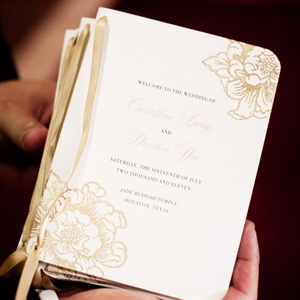 Caroline made the booklets herself with a peony stamp and gold ribbon.