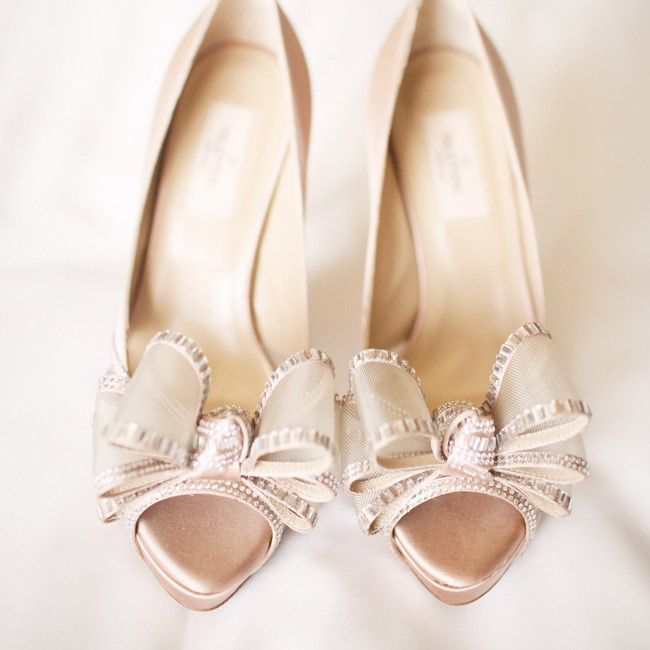Caroline loved her crystal-embellished peep-toe pumps in blush satin.