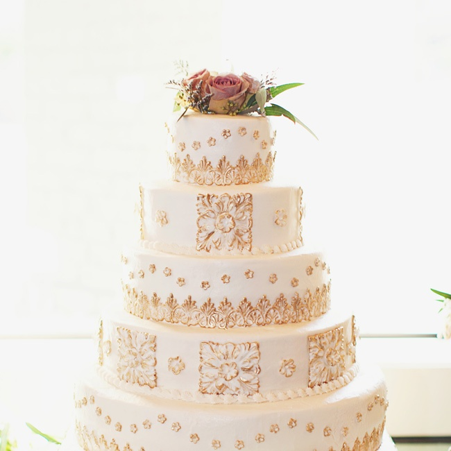 The traditional vanilla cake with a buttercream frosting was accented with square fondant pieces with a design that gave it the antique look Meredith was hoping for.