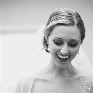 Meredith chose a veil by Lazaro edged in silver embroidery and beading that matched her Lazaro gown.