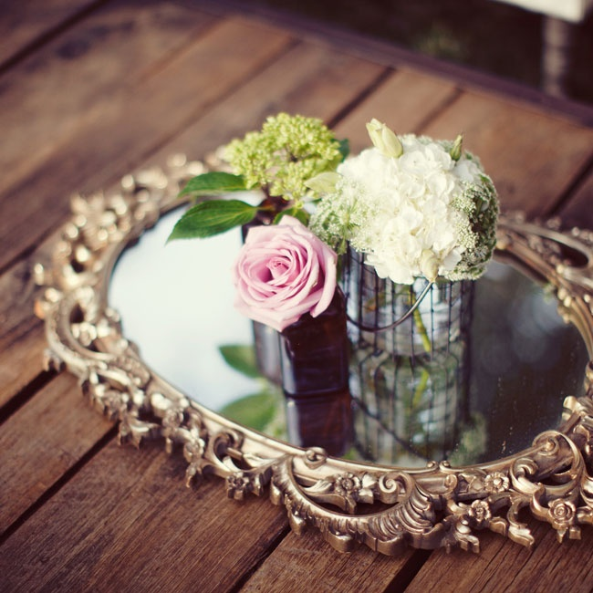 Vintage touches, like a gold-framed mirror, added an old-world spin to the reception.
